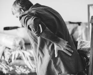 Before moving in to take care of an elderly man with an achy back who has trouble getting up to move around, you would want to know if he has any devices to assist in lifting  him if he falls or other mobility