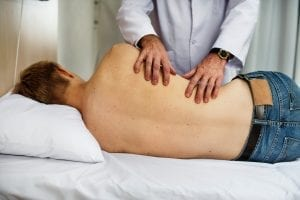 Performing chest percussion to help stimulate removal of secretions.
