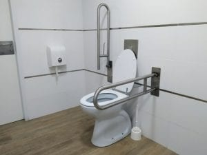 Bathroom fixtures adapted for use by someone with mobility limitations help make the room accessible.