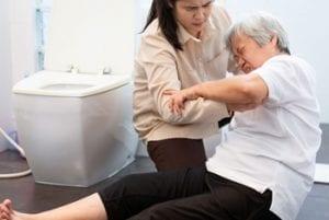 Caregiver assisting family member who has fallen.