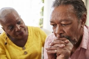 Caregiver supporting family member with mental health memory issues.