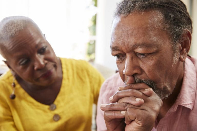 Caregiver supporting family member who has mental health challenges related to memory loss and depression.