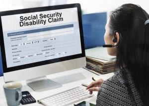 Caregiver looking up information about how to apply for a disability status with social security